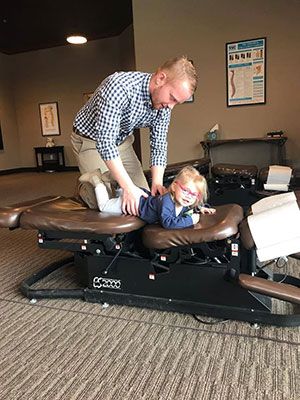 Chiropractor New Berlin WI Hamilton Dowden Adjusting Child